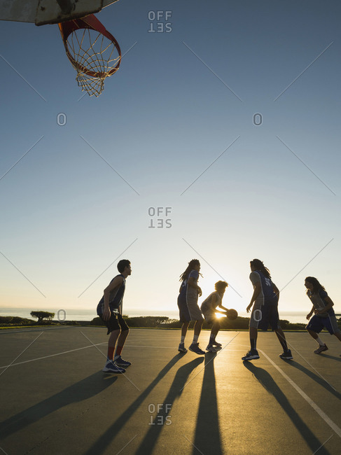 Basketball team playing on a court