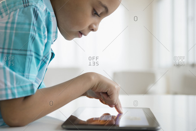 Young boy using tablet computer