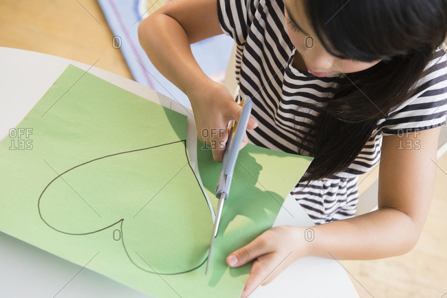 Girl cutting out paper hearts