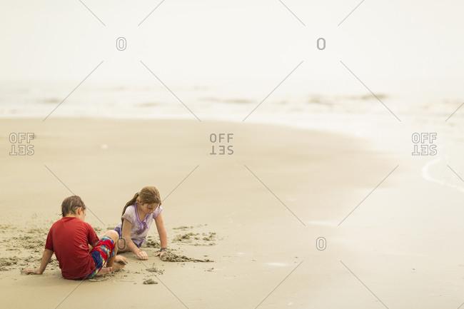 Children playing on a sandy beach
