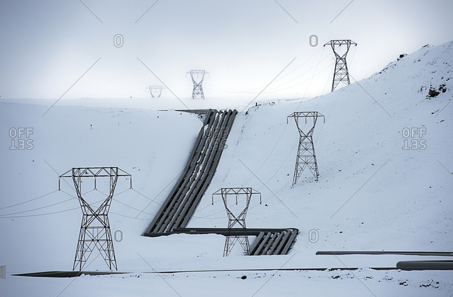 Power lines on a snowy hill