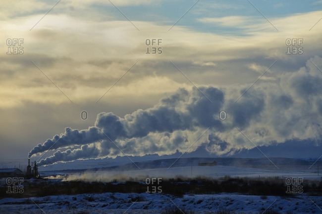 Steam billowing from a distant power plant in rural Iceland