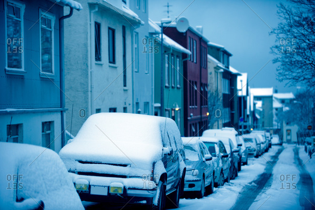 Snow covered cars parked on a street in Reykjavik, Iceland