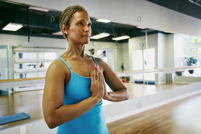 Woman practicing yoga in front of mirrors