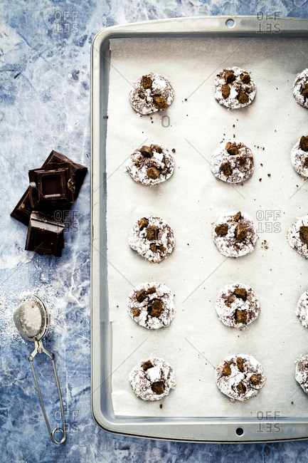Tray of baked chocolate cookies on marble background