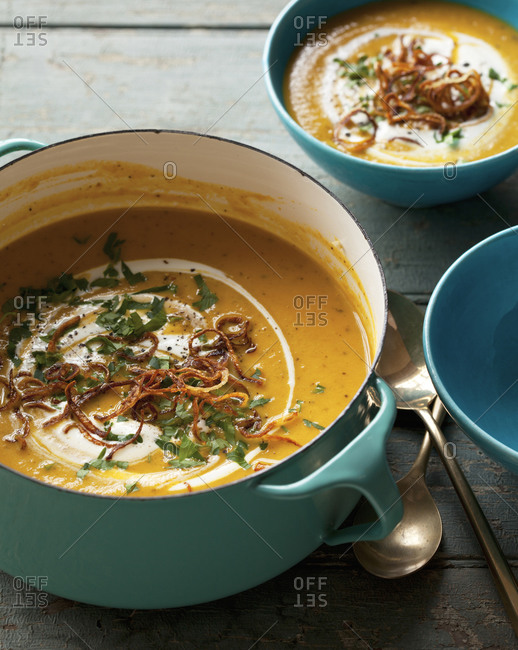 Spiced carrot and butterbean soup with fried shallot, parsley and yogurt