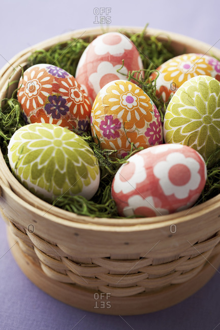 Round basket of decoupage Easter eggs
