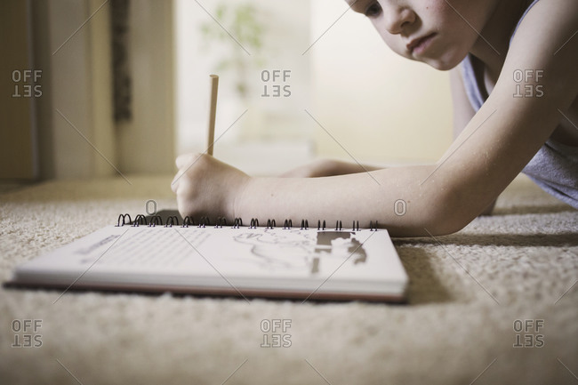 Young boy drawing in a workbook