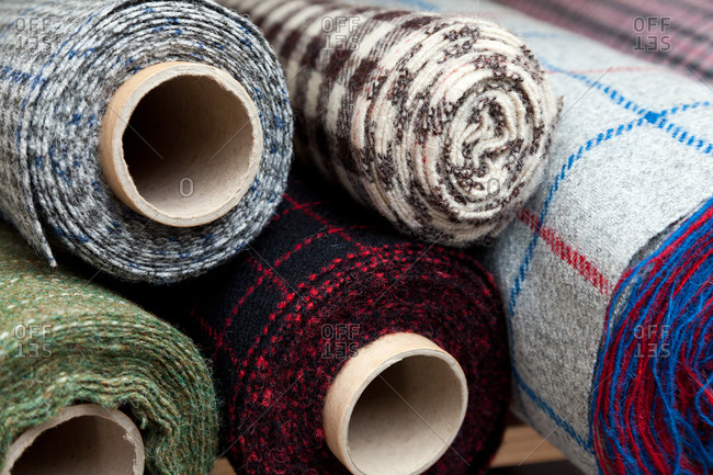 Bolts of woven wool plaid fabric