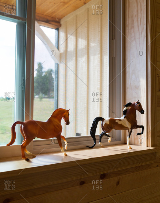 Toy horses on window sill