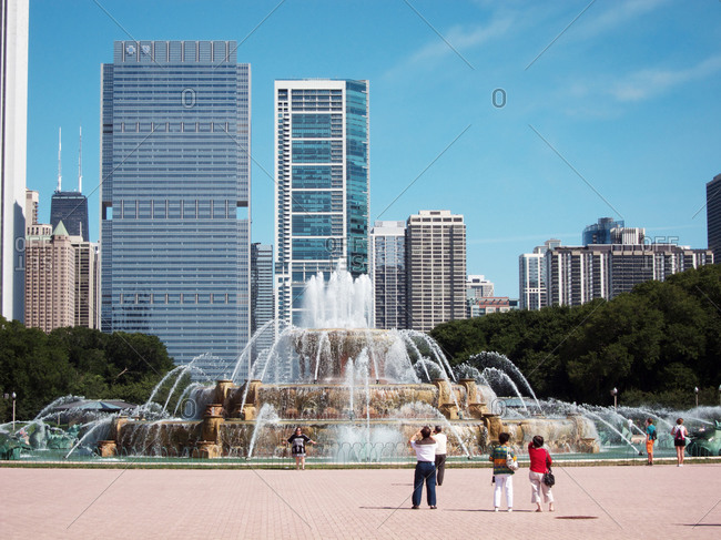 Chicago, Illinois, USA - August 21, 2011: Tourists taking picture of a fountain in Chicago