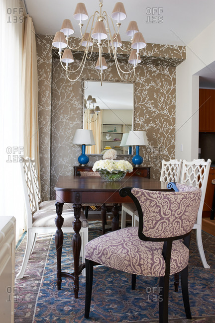 Neutral-colored dining room with blue oriental rug