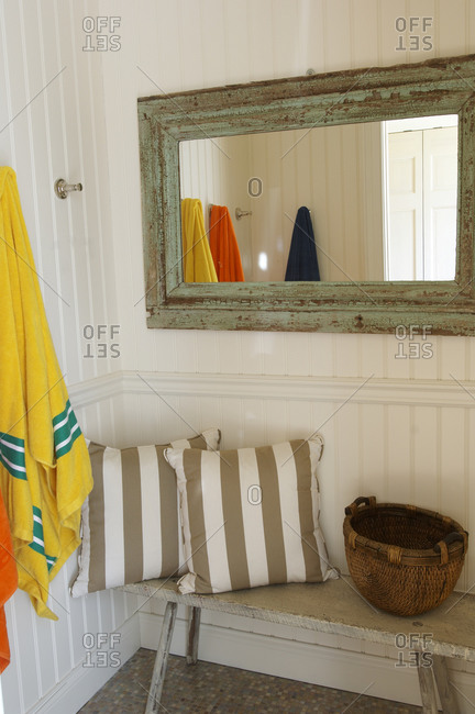 Casual beach house entry with towels hanging