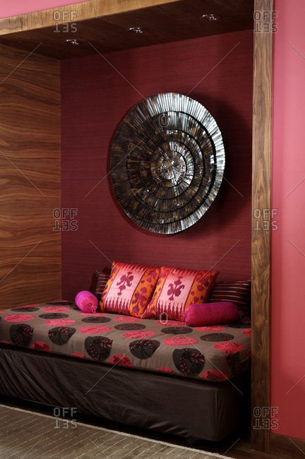 Exotic enclosed nook with daybed