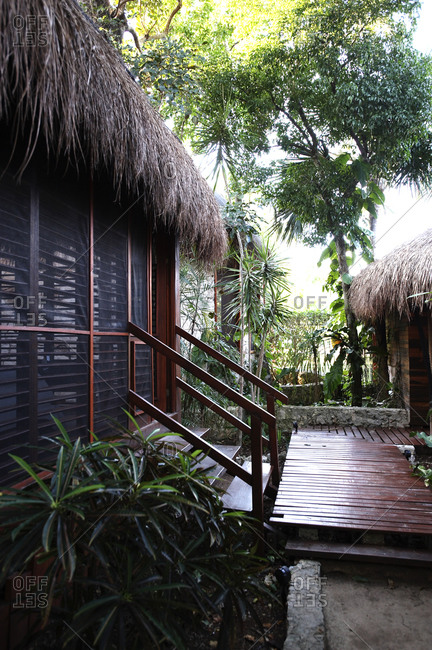 Outside walkway of a tropical thatch roof cottage