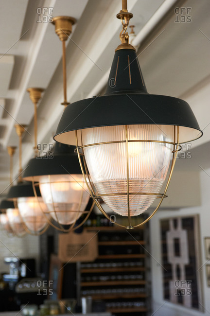 Row of vintage style pendant lights in a bar