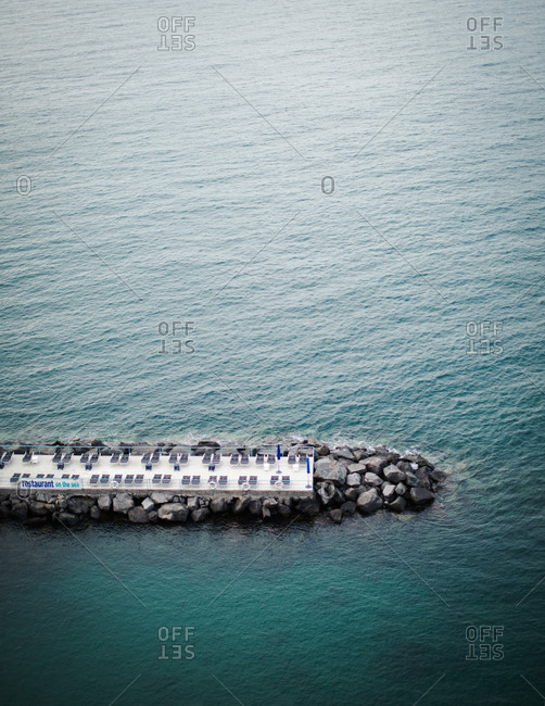 Sun loungers on a pier in Sorrento, Italy