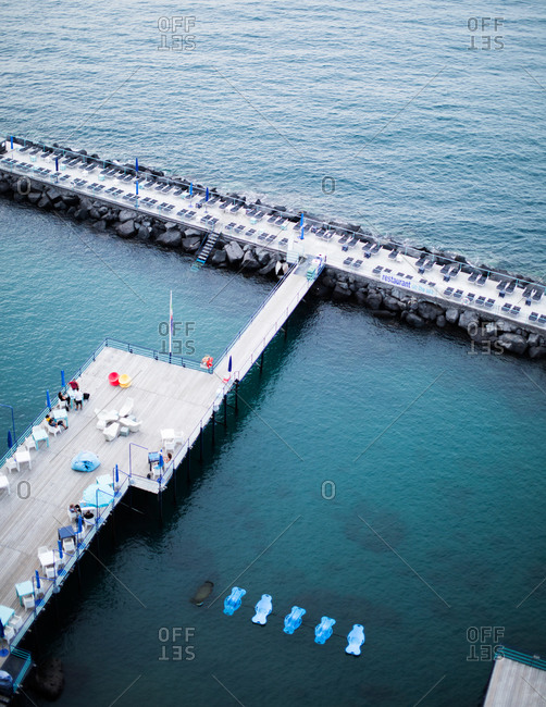 Sorrento, Italy - December 16, 2014: Restaurant and sun loungers on a pier in Sorrento