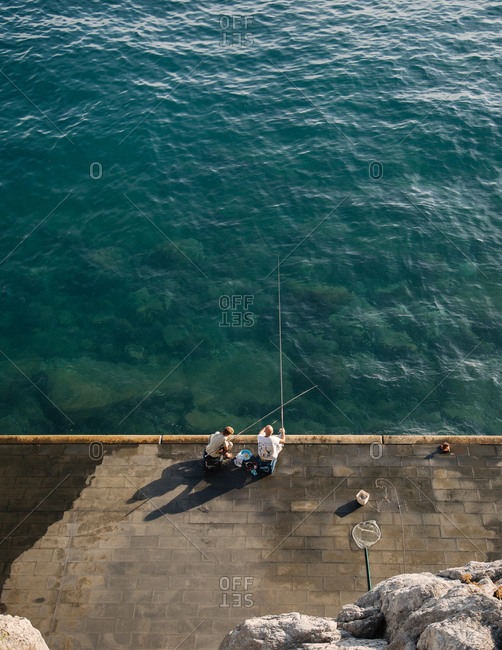 People fishing on the coast of Positano, Italy