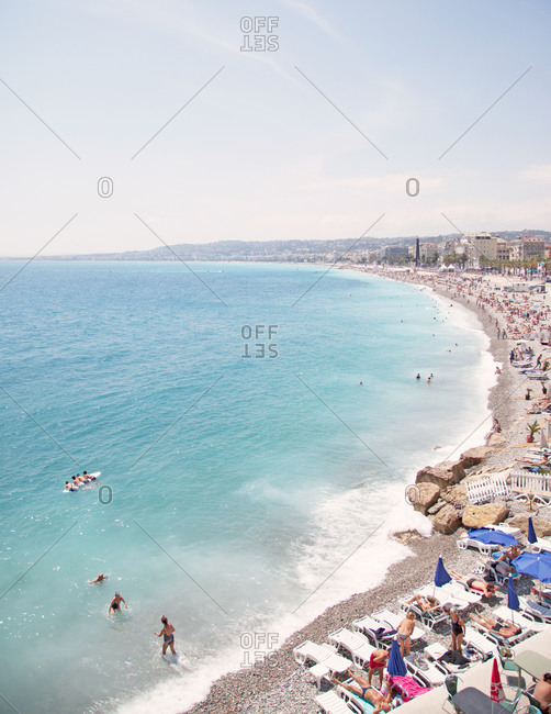 Nice, Cote D'Azur, France - July 5, 2014: People relaxing at the beach of Nice, Cote D'Azur, South of France