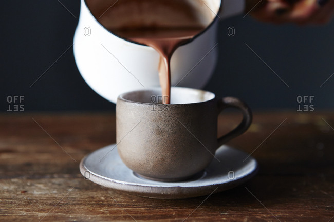 Pouring hot chocolate in demitasse cup
