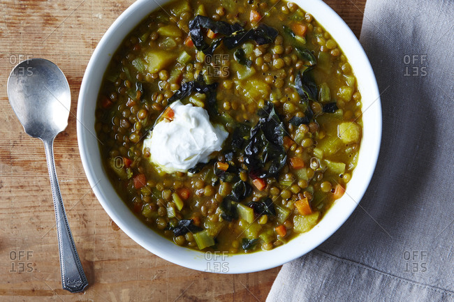 Lentil soup in bowl with dollop of cream
