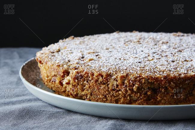 Pecan crusted oat flour sponge cake close up