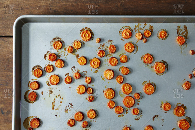 Round carrot slices roasted on pan