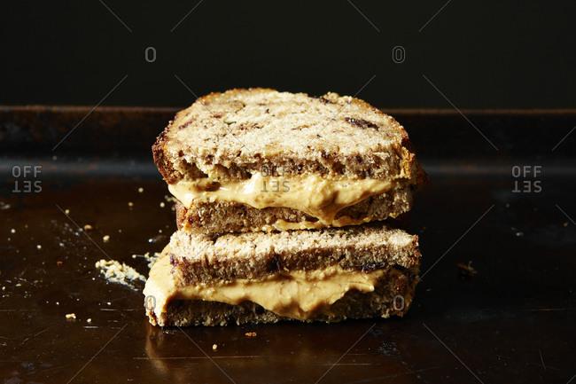 Stack of roasted peanut butter sandwich halves