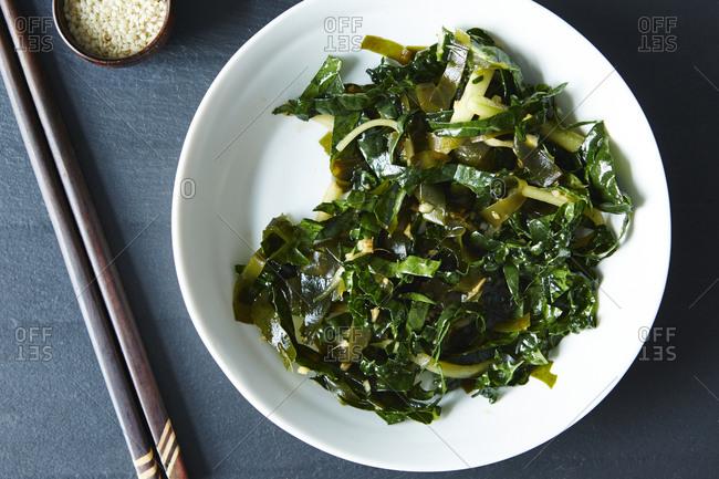 Bowl of seaweed salad with kale