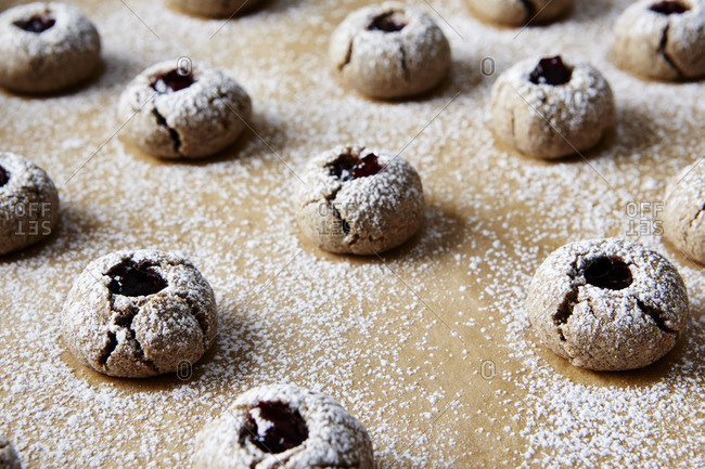 Buckwheat thumbprint cookies with cherry preserve filling