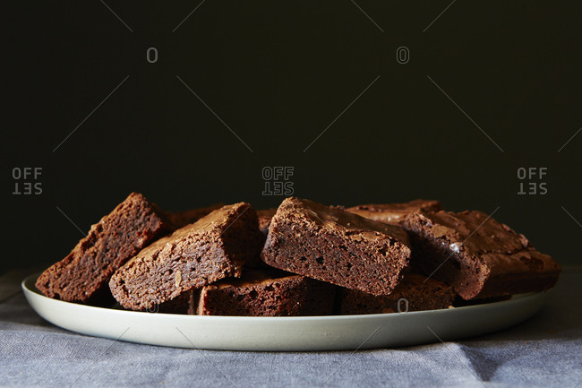 Stack of brownie squares on plates