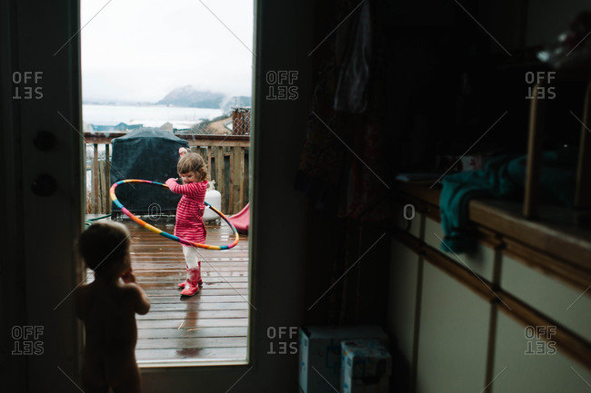 Young girl playing with a hula hoop