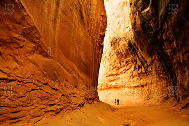 People hiking in Leprechaun Canyon, North Wash, Utah