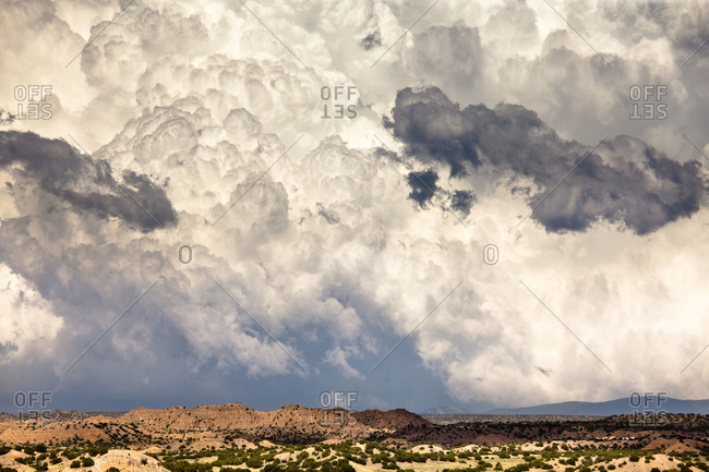 Thunderstorms roll across the landscape of New Mexico
