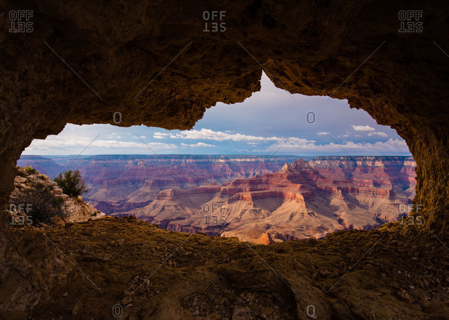 A natural window with a view of the Grand Canyon