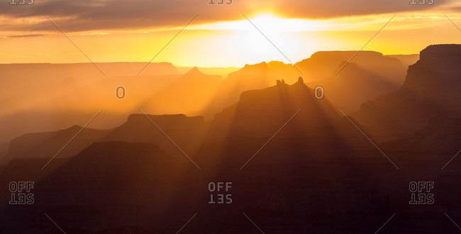 Rays of sunlight pass through the many temples and buttes of the Grand Canyon including Angel's Gate