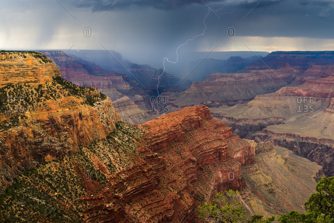 Lightning from a summer thunderstorm strikes near the Colorado River in the Grand Canyon National Park