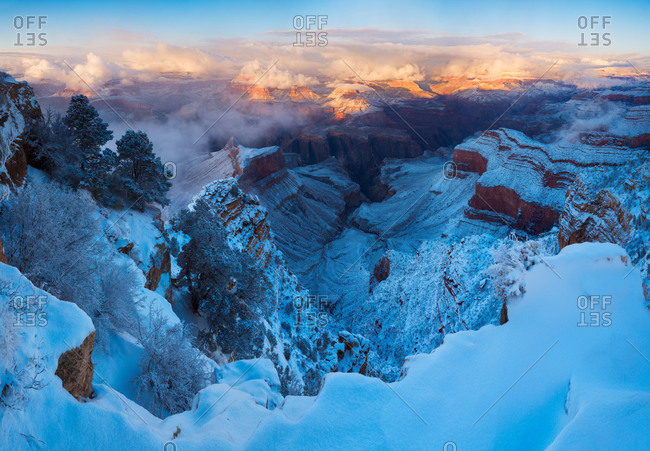 Sunrise at the snow-covered Grand Canyon in Arizona, USA