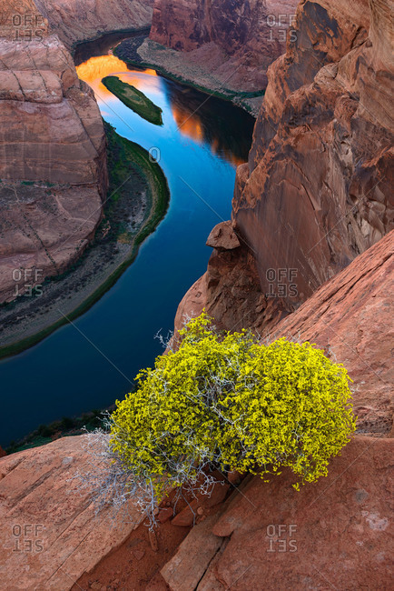 The Colorado River meanders beneath the cliffs of Horseshoe Bend in Arizona, USA