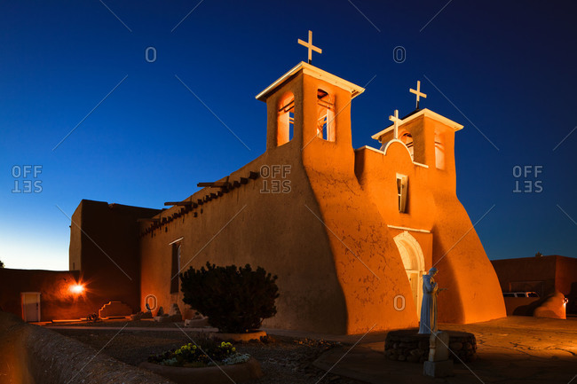 Exterior of the San Francisco de Asis Church at night in Ranchos de Taos, New Mexico, USA