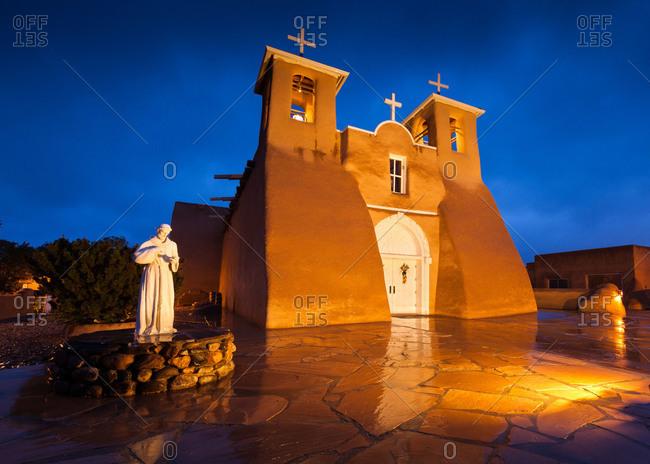 San Francisco de Asis church at night in Ranchos de Taos, New Mexico, USA