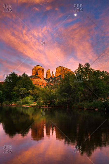 The moon rising above Cathedral Rock at Red Rock Crossing in Sedona, Arizona, USA