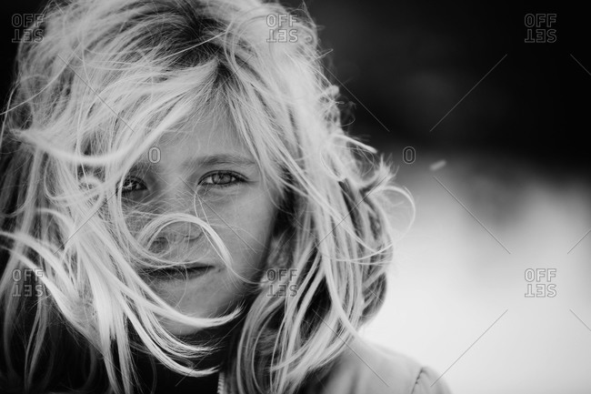 Portrait of wind blown girl in black and white