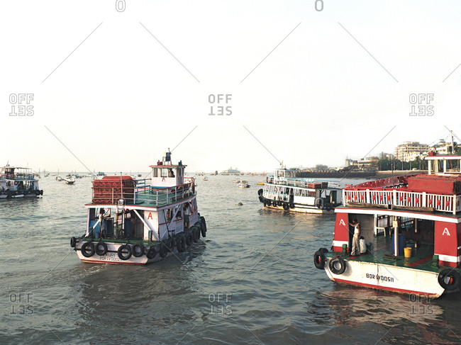 Mumbai, India - February 8, 2015: Several ferries in Indian harbor