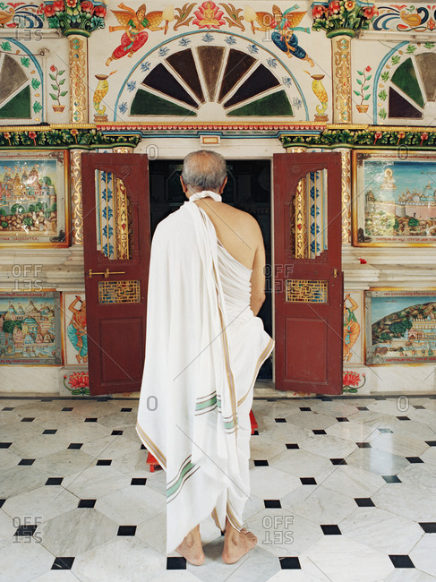 Mumbai, India - February 8, 2015: Man worshipping at Jain temple in India