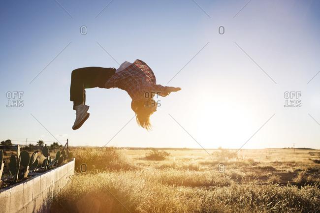 Young man doing a backflip