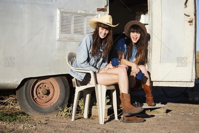 Young women having fun at a trailer