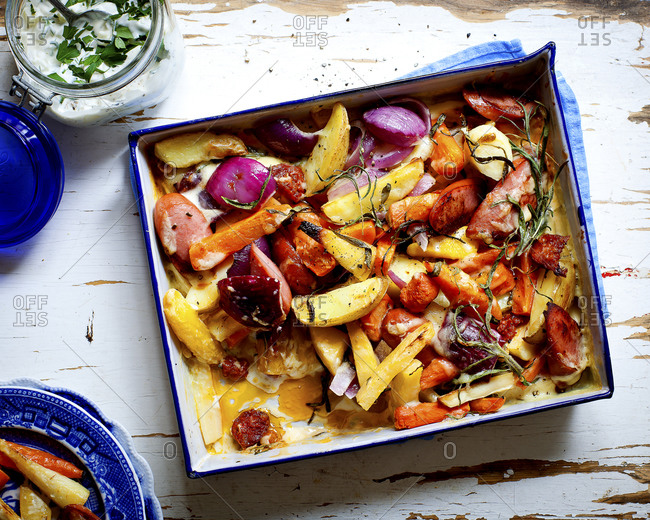 Roasted vegetables with sausage slices