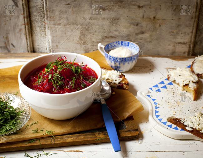 Bowl of borscht with bruschetta